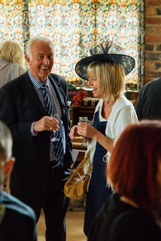 Special-Day-Photography-Prestbury-WI-Hall-Cheltenham-Prestbury-Church-Wedding-guests-at-the-rcepetion.jpg