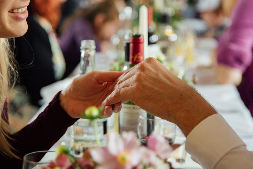 Special-Day-Photography-Prestbury-WI-Hall-Cheltenham-Prestbury-Church-Wedding-guests-holding-hands.jpg
