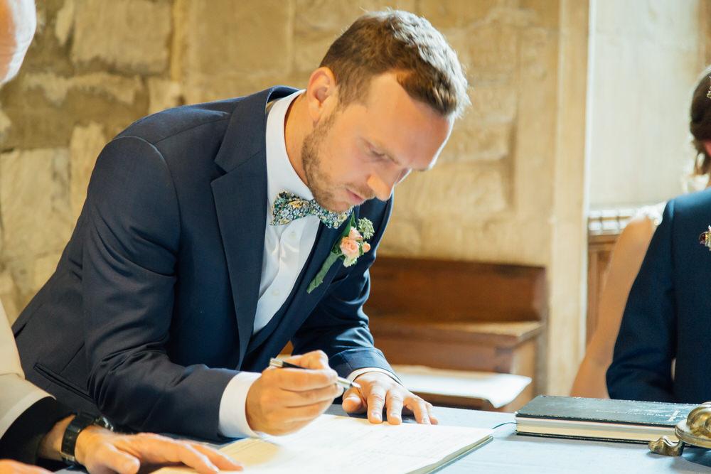 Special-Day-Photography-Prestbury-WI-Hall-Cheltenham-Prestbury-Church-Wedding-signing-the-registers.jpg