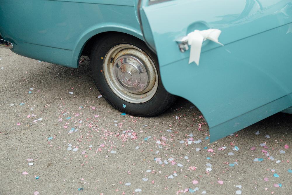 Special-Day-Photography-Prestbury-WI-Hall-Cheltenham-Prestbury-Church-Wedding-vintage-car-and-confetti-detail.jpg