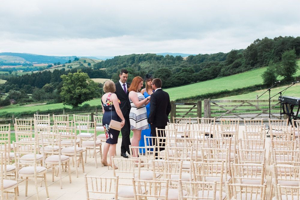 Special-Day-Photography-The-Bringewood-Ludlow-The-Bringewood-Hillside-Wedding-Guests-arriving-at-an-outdoor-wedding.jpg