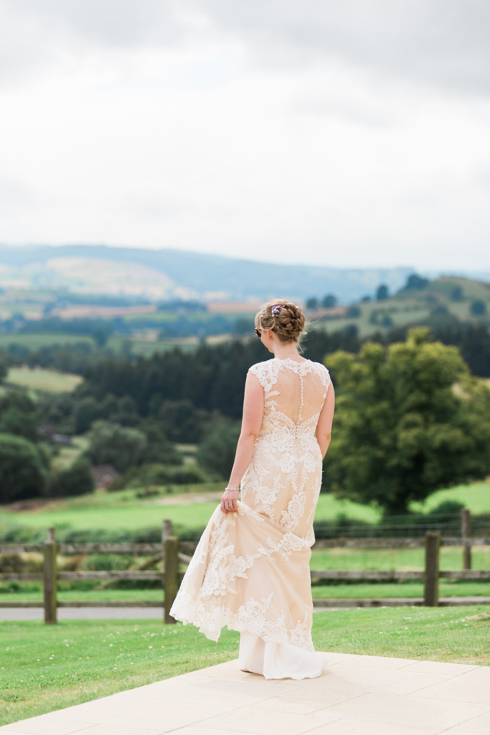 Special-Day-Photography-The-Bringewood-Ludlow-The-Bringewood-Hillside-Wedding-a-bride-looks-out-over-the-hills.jpg