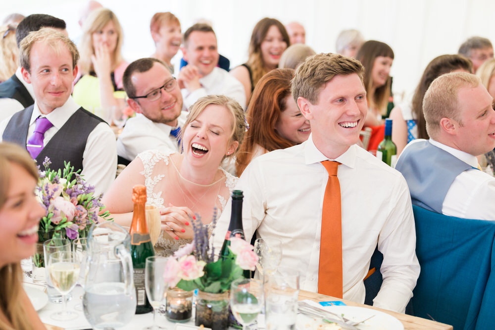 Special-Day-Photography-The-Bringewood-Ludlow-The-Bringewood-Hillside-Wedding-bride-and-groom-laughing-during-speeches.jpg