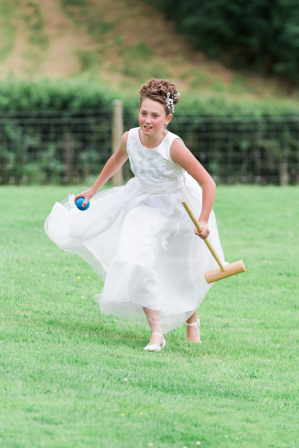 Special-Day-Photography-The-Bringewood-Ludlow-The-Bringewood-Hillside-Wedding-flower-girl-playing-lawn-games.jpg