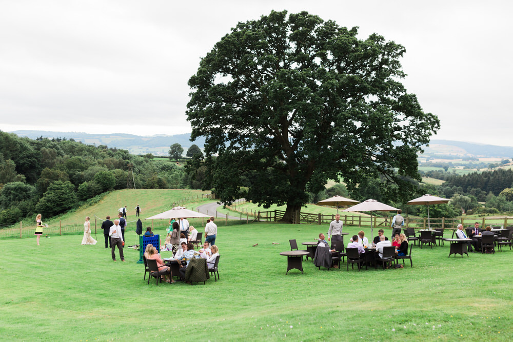 Special-Day-Photography-The-Bringewood-Ludlow-The-Bringewood-Hillside-Wedding-guests-enjoying-the-summer-sun-outdoors.jpg