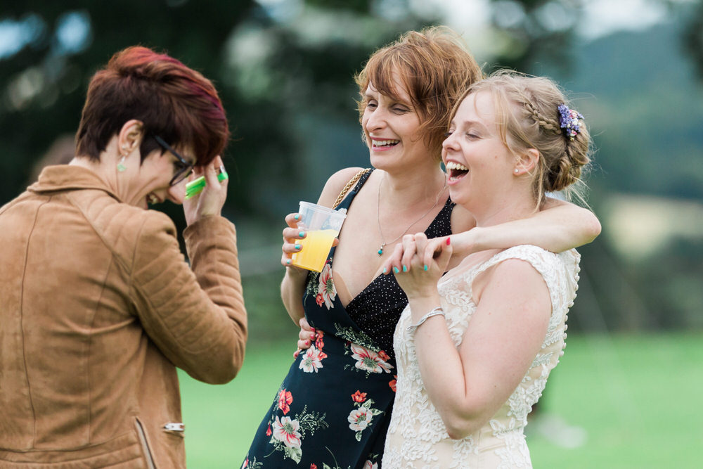 Special-Day-Photography-The-Bringewood-Ludlow-The-Bringewood-Hillside-Wedding-guests-laughing.jpg