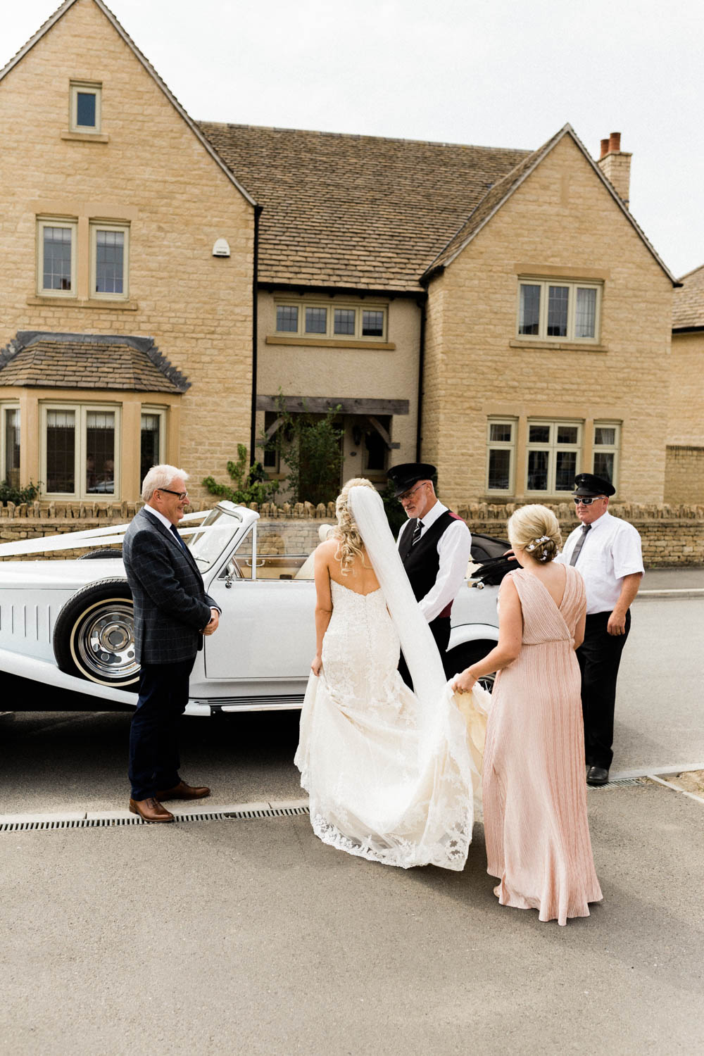 Special-Day-Photography-The-Manor-House-Hotel-Moreton-in-Marsh-Moreton-In-Marsh-Summer-Wedding-A-bride-getting-in-her-vintage-wedding-car.jpg