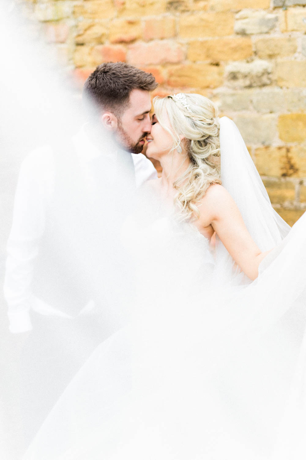 Special-Day-Photography-The-Manor-House-Hotel-Moreton-in-Marsh-Moreton-In-Marsh-Summer-Wedding-A-veil-covers-the-bride-and-groom-in-a-portrait-photo.jpg