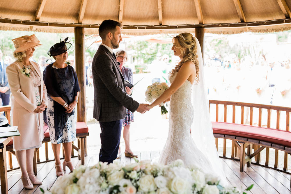 Special-Day-Photography-The-Manor-House-Hotel-Moreton-in-Marsh-Moreton-In-Marsh-Summer-Wedding-Bride-and-groom-saying-their-vows-in-an-outdoor-wedding.jpg