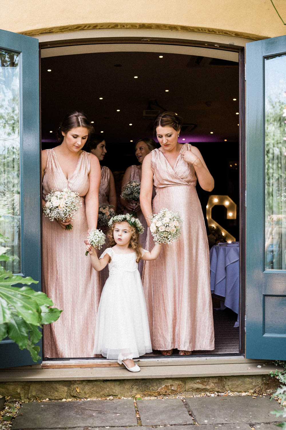 Special-Day-Photography-The-Manor-House-Hotel-Moreton-in-Marsh-Moreton-In-Marsh-Summer-Wedding-Bridesmaids-and-flower-girl-preparing-to-walk-down-the-aisle.jpg