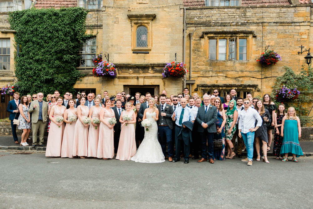 Special-Day-Photography-The-Manor-House-Hotel-Moreton-in-Marsh-Moreton-In-Marsh-Summer-Wedding-Group-photograph-outside-the-venue-in-the-Cotswolds.jpg