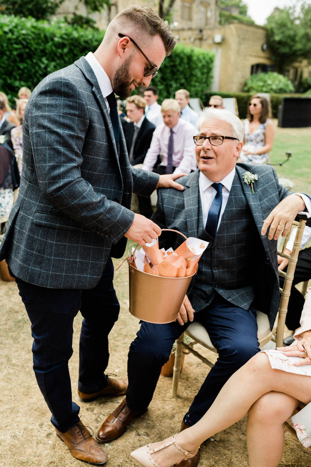 Special-Day-Photography-The-Manor-House-Hotel-Moreton-in-Marsh-Moreton-In-Marsh-Summer-Wedding-The-best-man-gives-confetti-to-guests.jpg