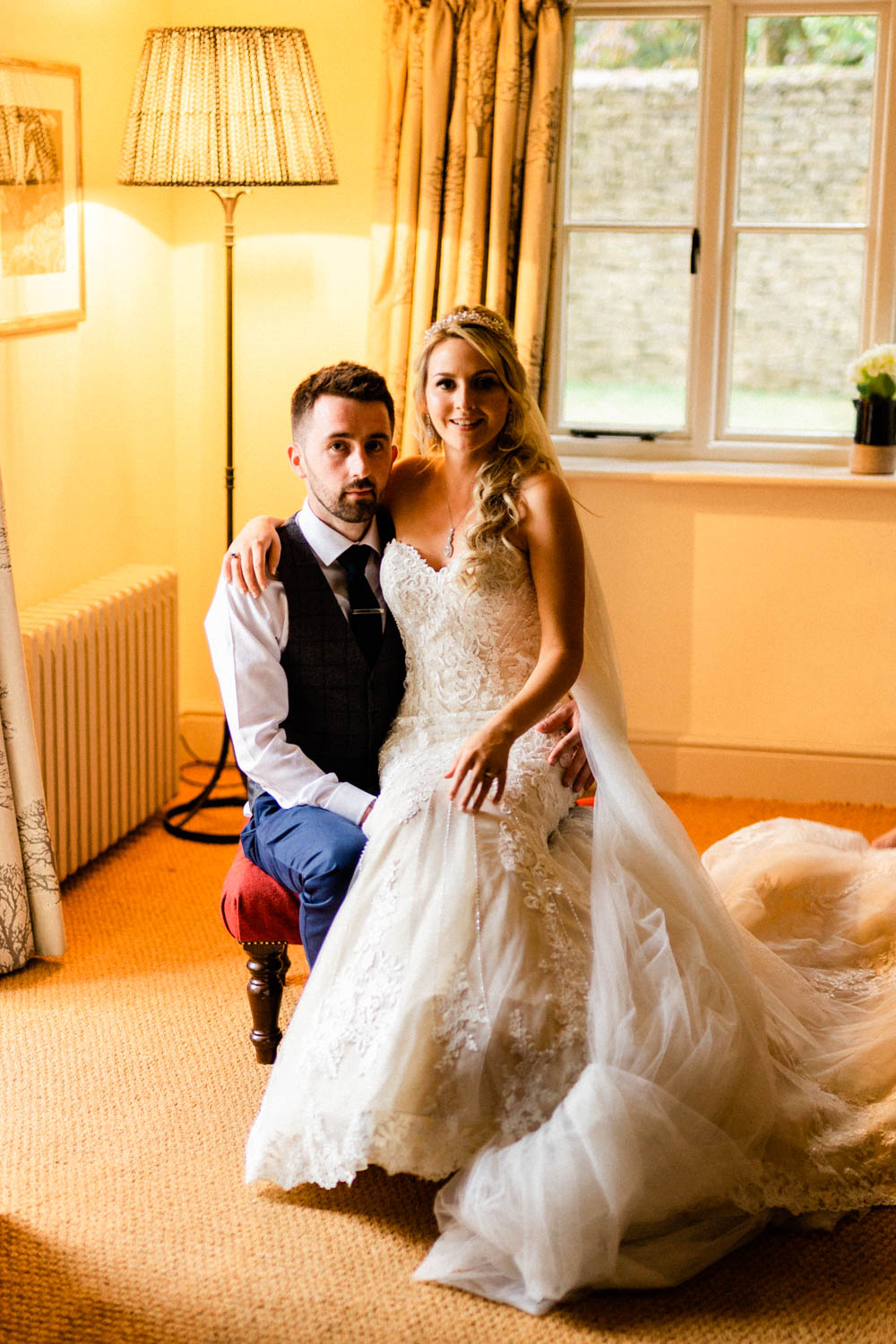 Special-Day-Photography-The-Manor-House-Hotel-Moreton-in-Marsh-Moreton-In-Marsh-Summer-Wedding-The-bride-and-groom-sitting-for-a-portrait.jpg