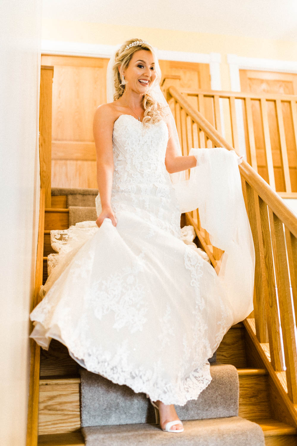 Special-Day-Photography-The-Manor-House-Hotel-Moreton-in-Marsh-Moreton-In-Marsh-Summer-Wedding-The-bride-walking-down-the-stairs-at-her-house.jpg