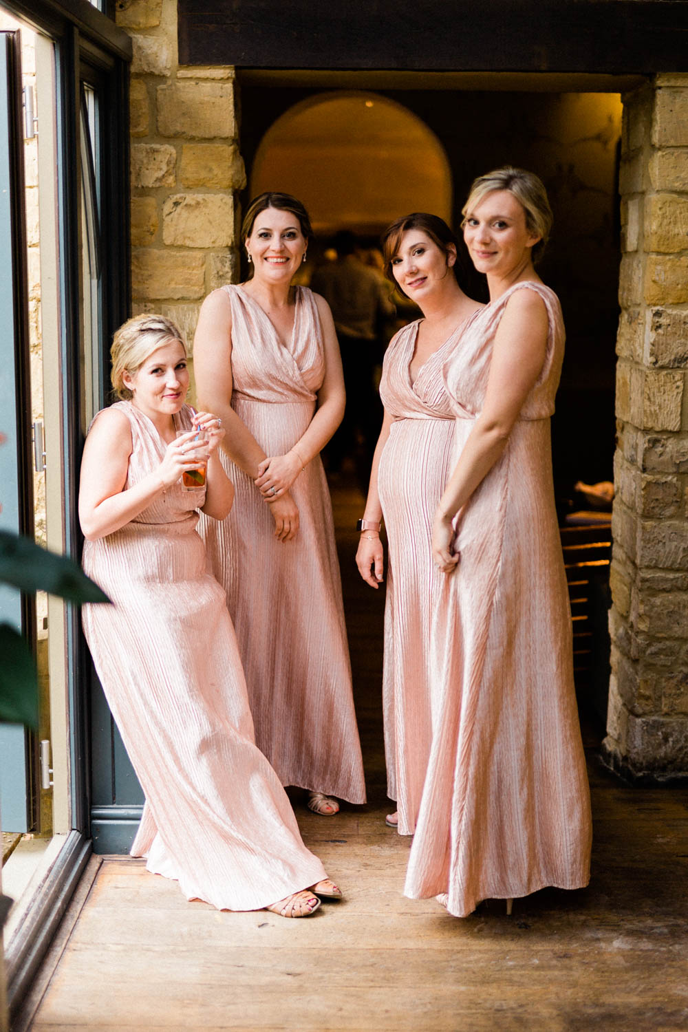 Special-Day-Photography-The-Manor-House-Hotel-Moreton-in-Marsh-Moreton-In-Marsh-Summer-Wedding-The-bridemaids-relax-during-wedding.jpg