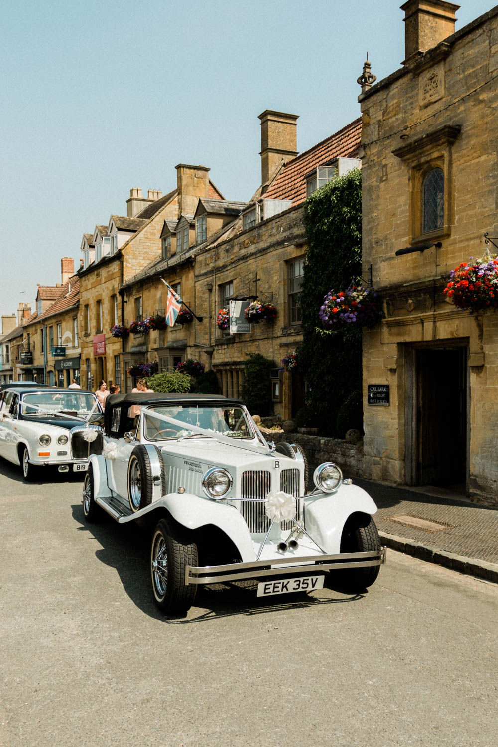 Special-Day-Photography-The-Manor-House-Hotel-Moreton-in-Marsh-Moreton-In-Marsh-Summer-Wedding-Vintage-car-waiting-outside-a-wedding-venue-in-the-Cotswolds.jpg