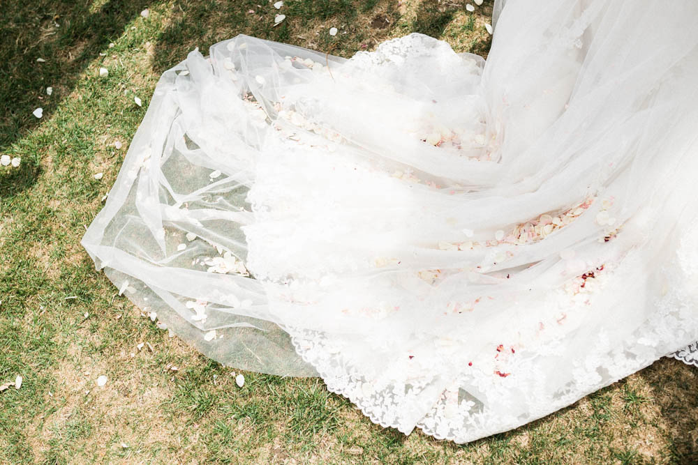 Special-Day-Photography-The-Manor-House-Hotel-Moreton-in-Marsh-Moreton-In-Marsh-Summer-Wedding-confetti-caught-in-the-bridal-train.jpg