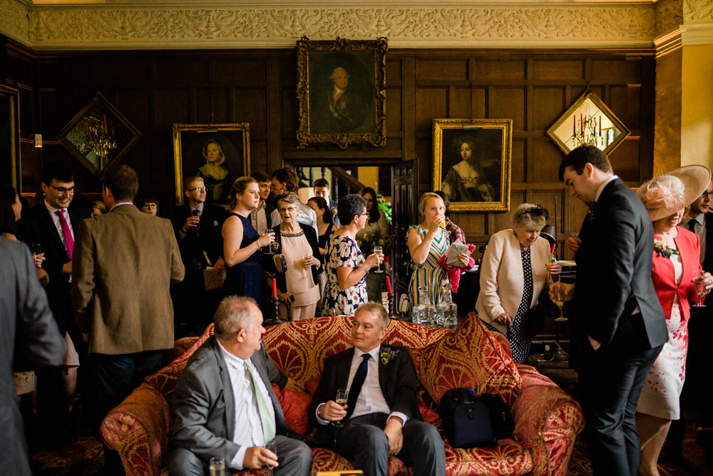 Special-Day-Photography-Hellens-Manor-Much-Marcle-Tudor-Manor-Wedding-guests-enjoying-Jacobean-architecture.jpg