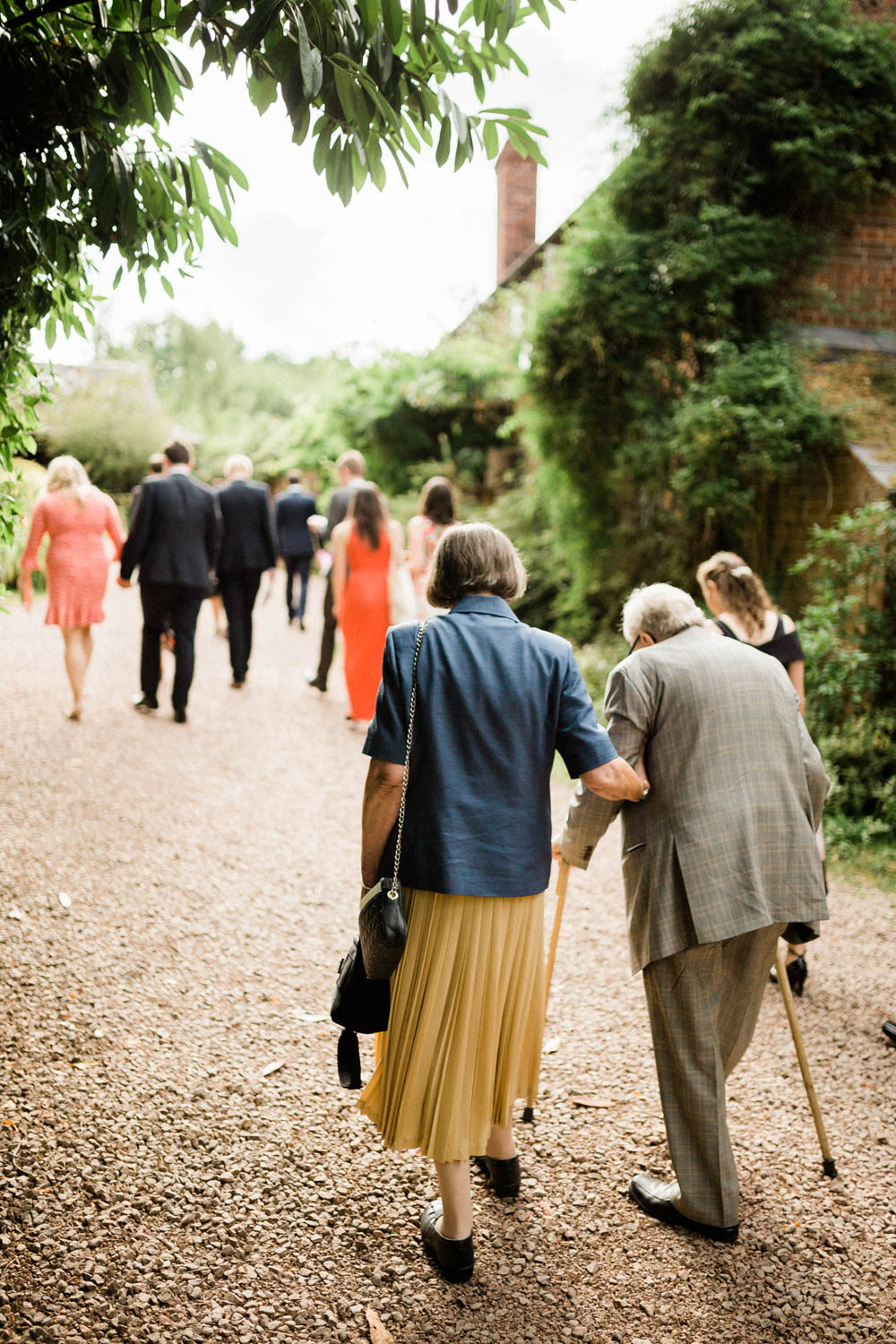 Special-Day-Photography-Hellens-Manor-Much-Marcle-Tudor-Manor-Wedding-guests-walking-to-the-wedding-breakfast.jpg