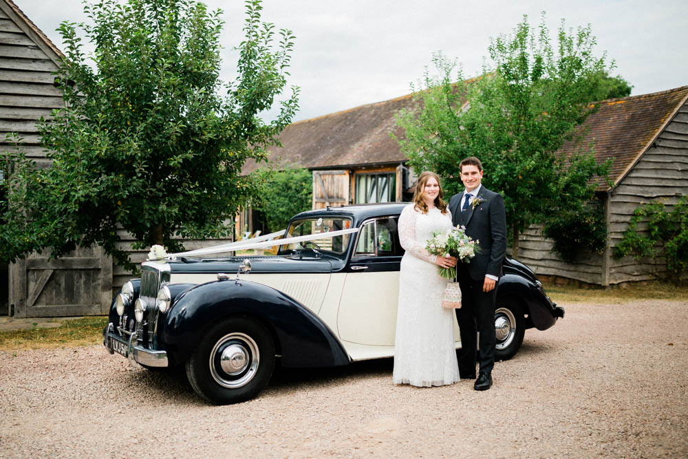 Special-Day-Photography-Hellens-Manor-Much-Marcle-Tudor-Manor-Wedding-official-portraits-with-vintage-car.jpg