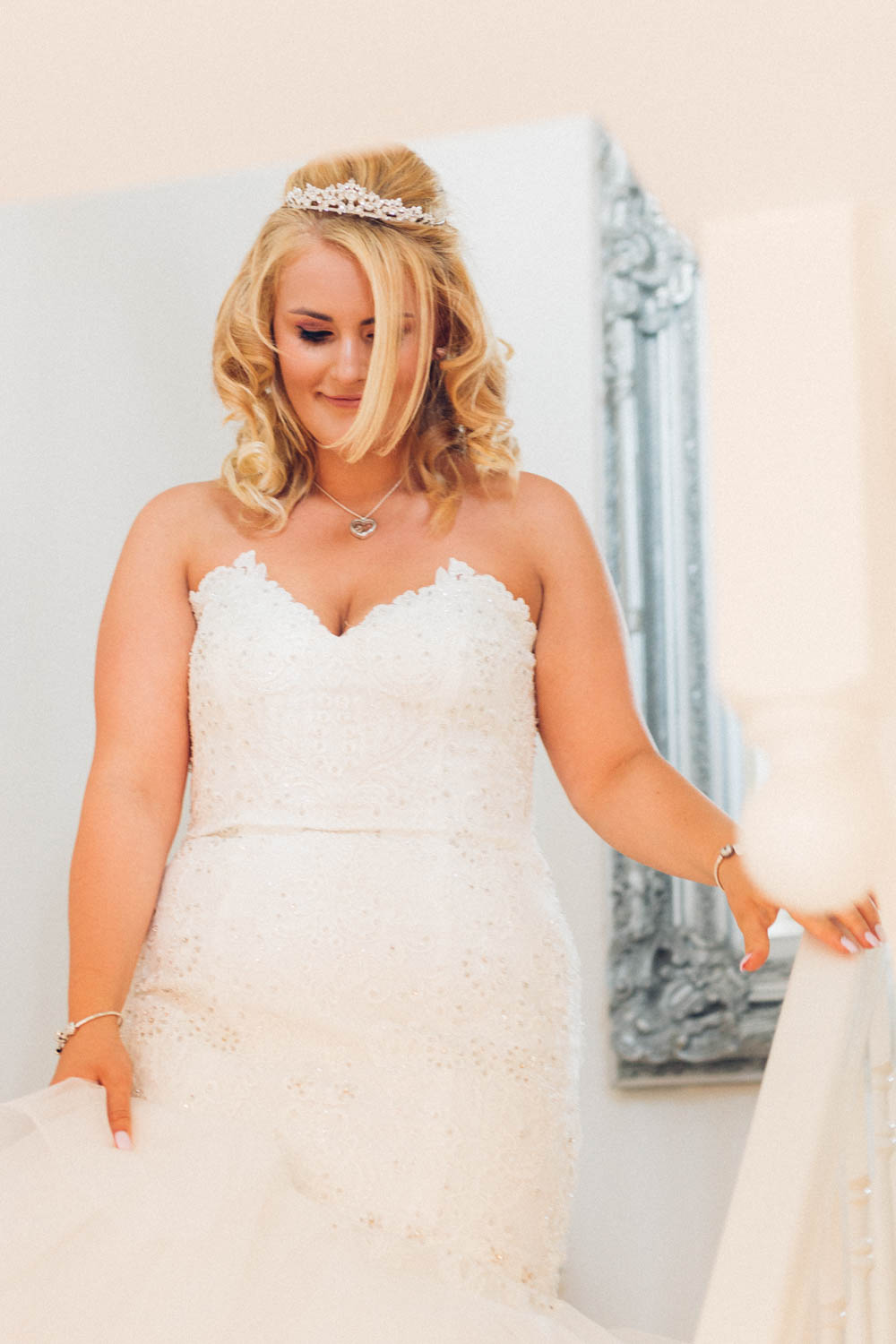 Special-Day-Photography-Manor-By-The-Lake-Cheltenham-Cheltenham-Manor-Wedding-bride-walking-down-the-stairs.jpg