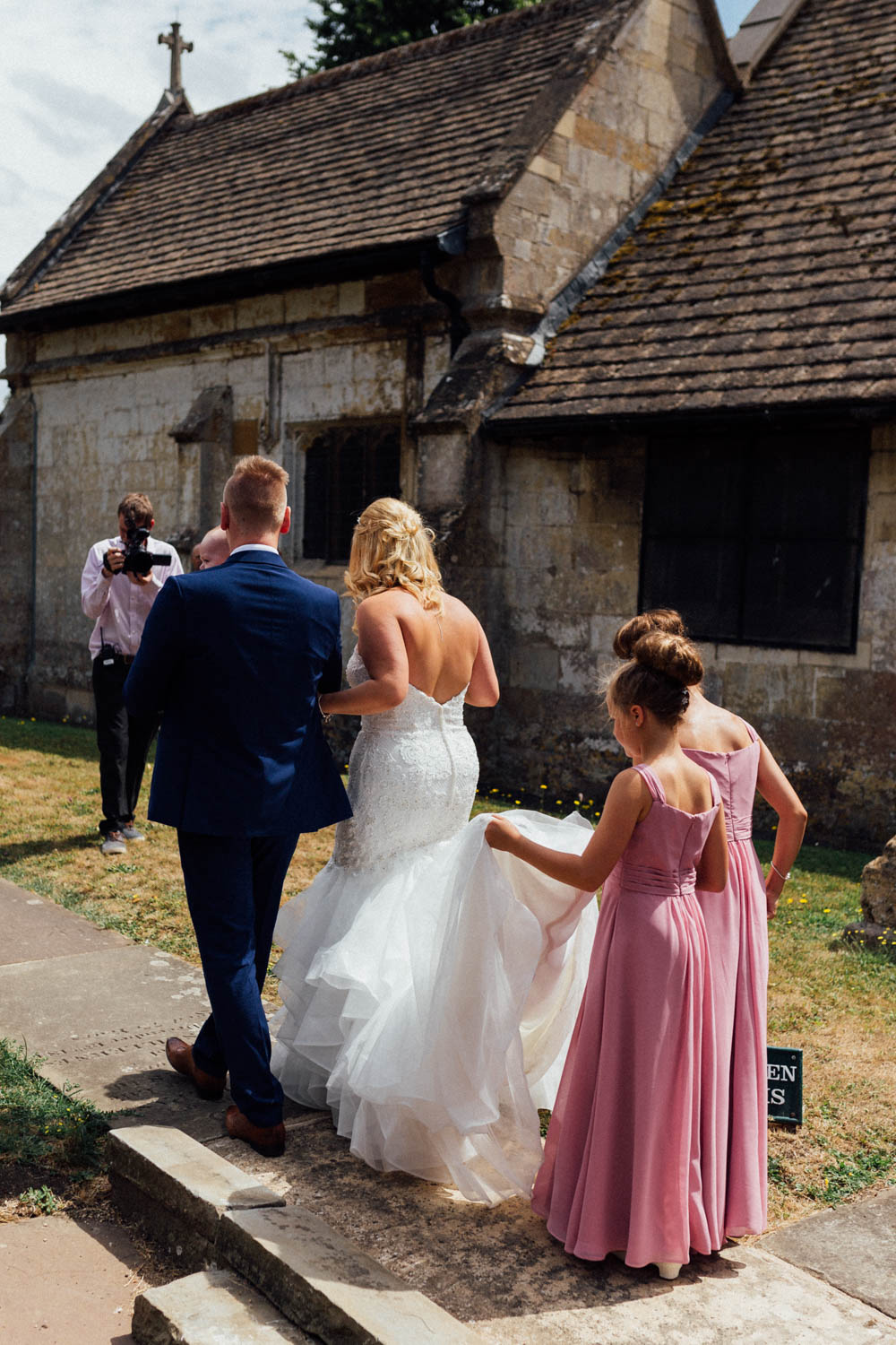 Special-Day-Photography-Manor-By-The-Lake-Cheltenham-Cheltenham-Manor-Wedding-flower-girl-helps-carry-the-train.jpg