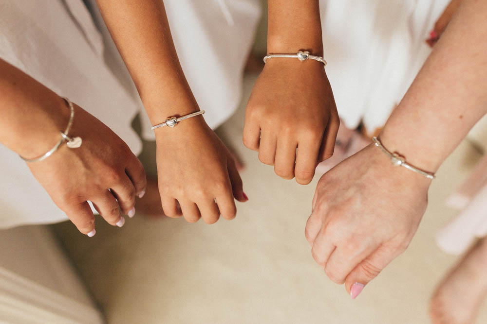 Special-Day-Photography-Manor-By-The-Lake-Cheltenham-Cheltenham-Manor-Wedding-matching-wedding-bracelets.jpg