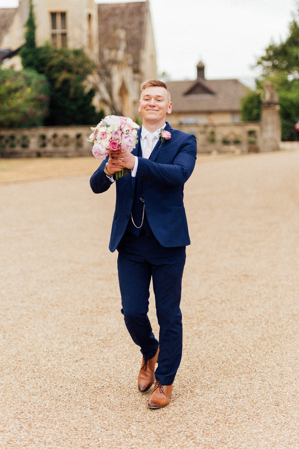 Special-Day-Photography-Manor-By-The-Lake-Cheltenham-Cheltenham-Manor-Wedding-the-groom-holding-the-bouquet.jpg