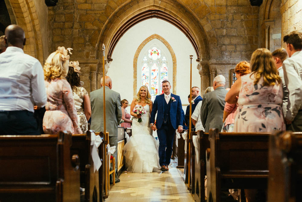 Special-Day-Photography-Manor-By-The-Lake-Cheltenham-Cheltenham-Manor-Wedding-walking-down-the-aisle-as-husband-and-wife.jpg