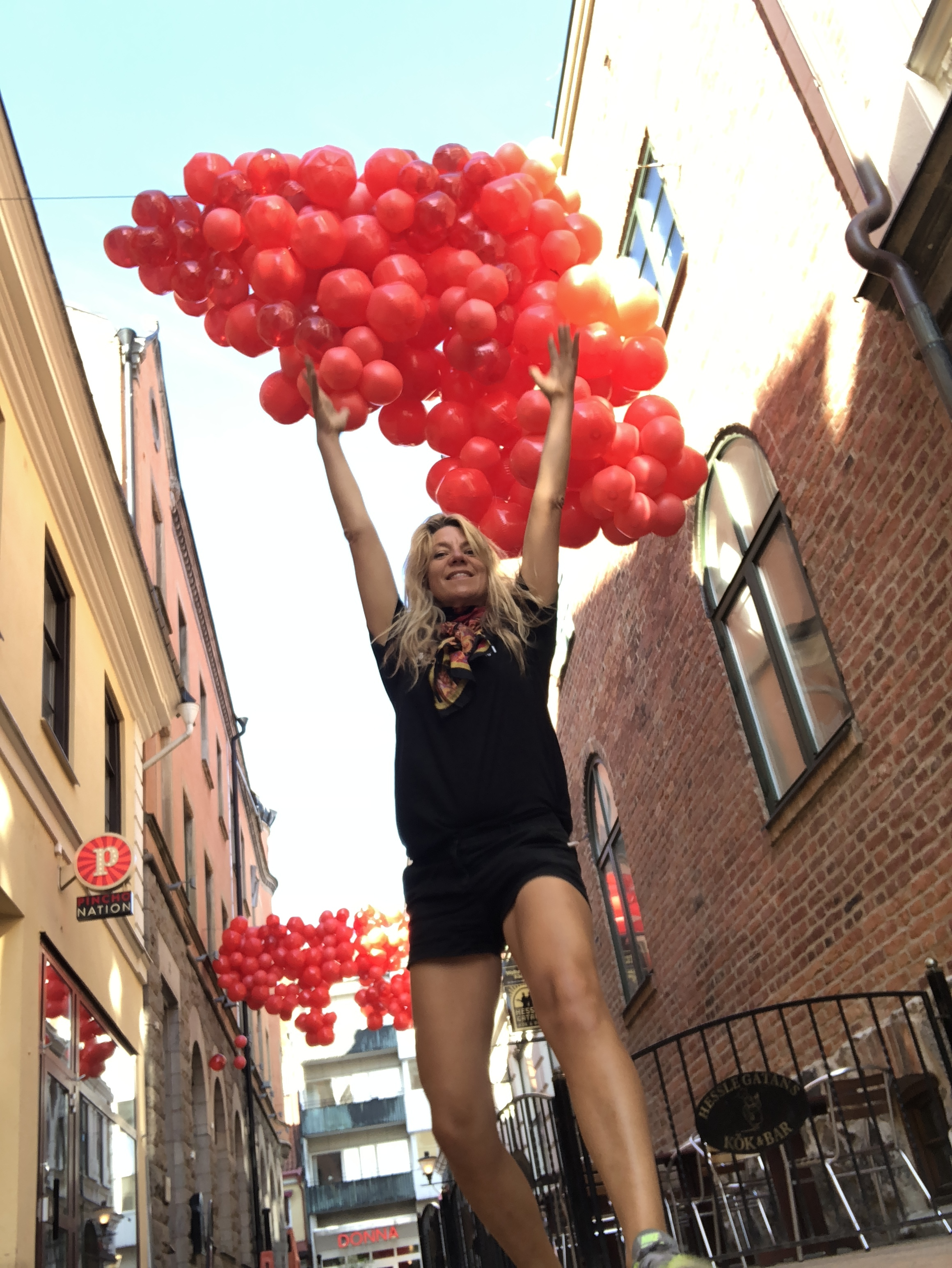 """""""Red cloud"""" - beach balls - an hommage to the water kingdom in Kristianstad that is sitauted at the lowest sea level point in Sweden. A wake up call for the climate changes with more rain and rising water level that can damage the bionynamics and the city center."""