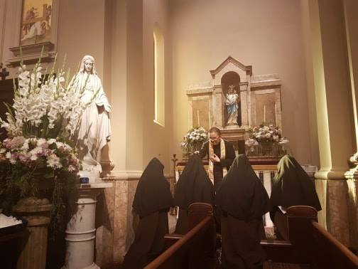 Fr Duncan Wong FSSP blesses the Nuns at Our Lady's side altar.