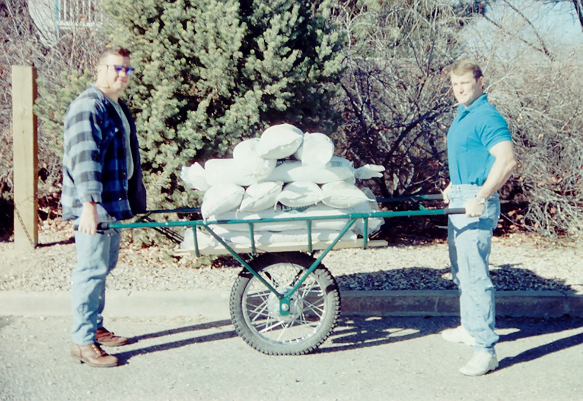 Paul Gaucher (left) and Jim Salisbury with 15 seventy lb. sandbags (1050 lb.). This load was no strain for a  GameTote  (unless you count the partially flattened tire).