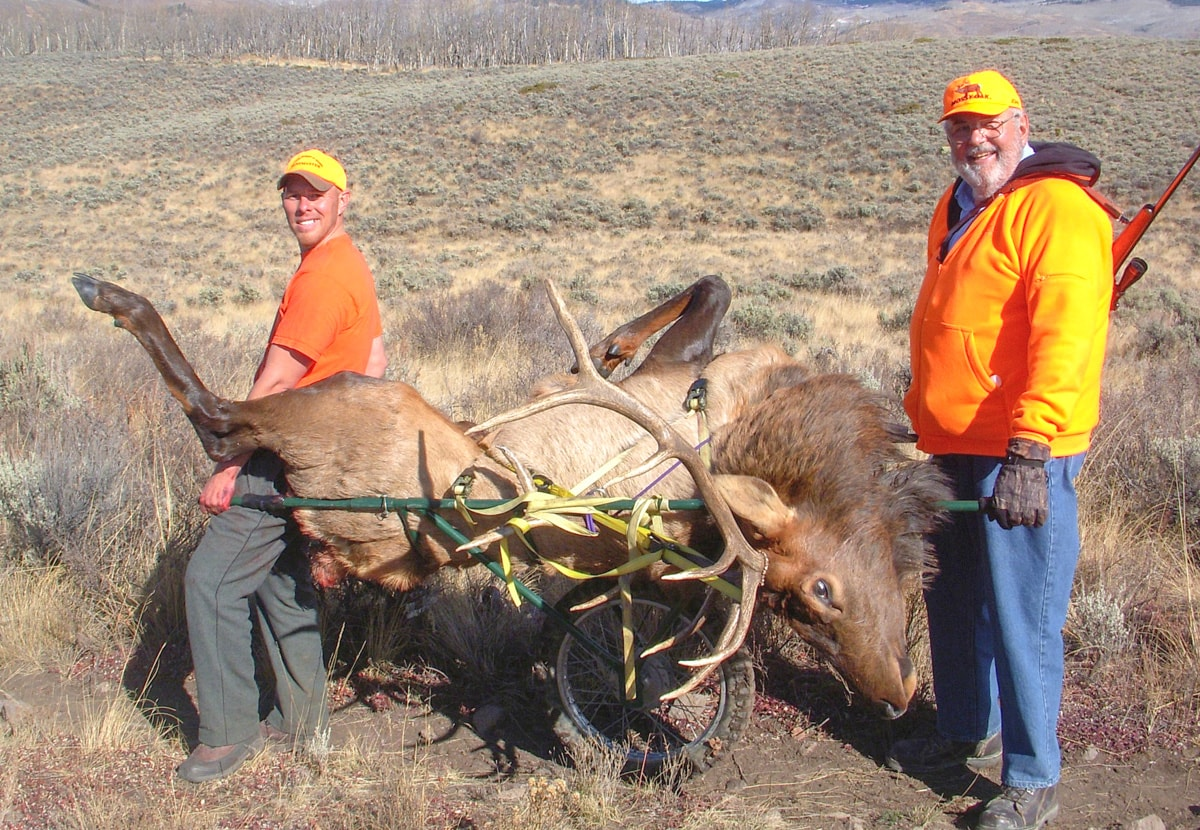 5X5 BULL ELK - Jon Esquibel & John Bobela retrieve 5 x 5 bull with a GameTote.