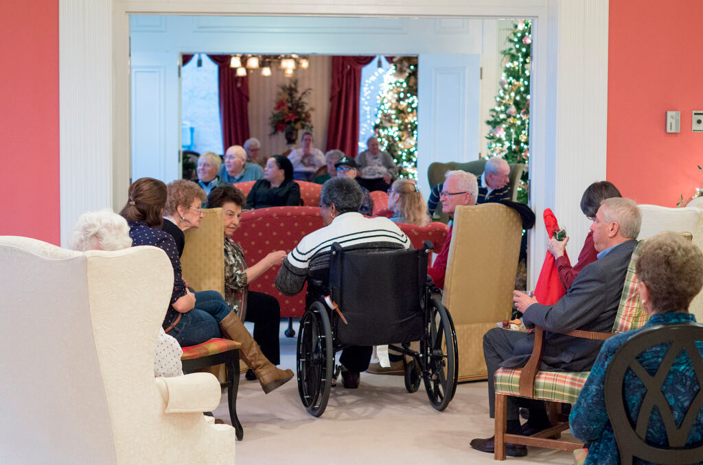 Residents, staff, and families enjoy a festive Christmas party together at St. Louis Altenheim.