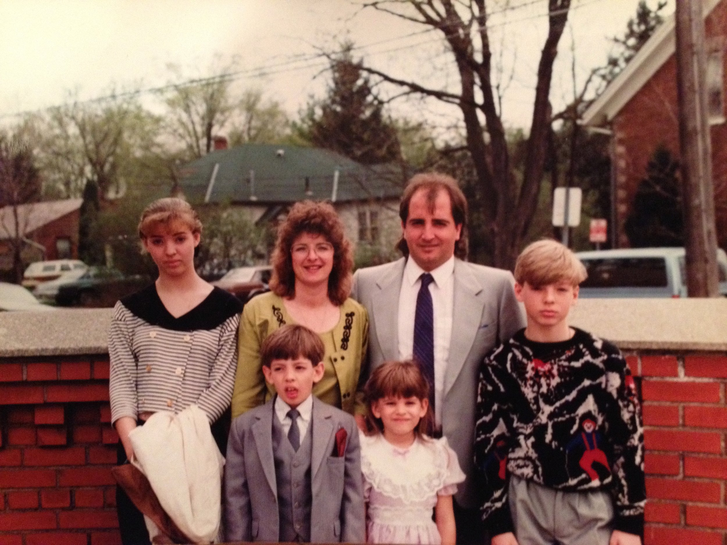 Awkward family photo circa 1990. Heading to my brother Paul's First Communion. From back left: sister Joanne, mom Lorraine, dad Sam, brothers Scott, Paul, and myself.