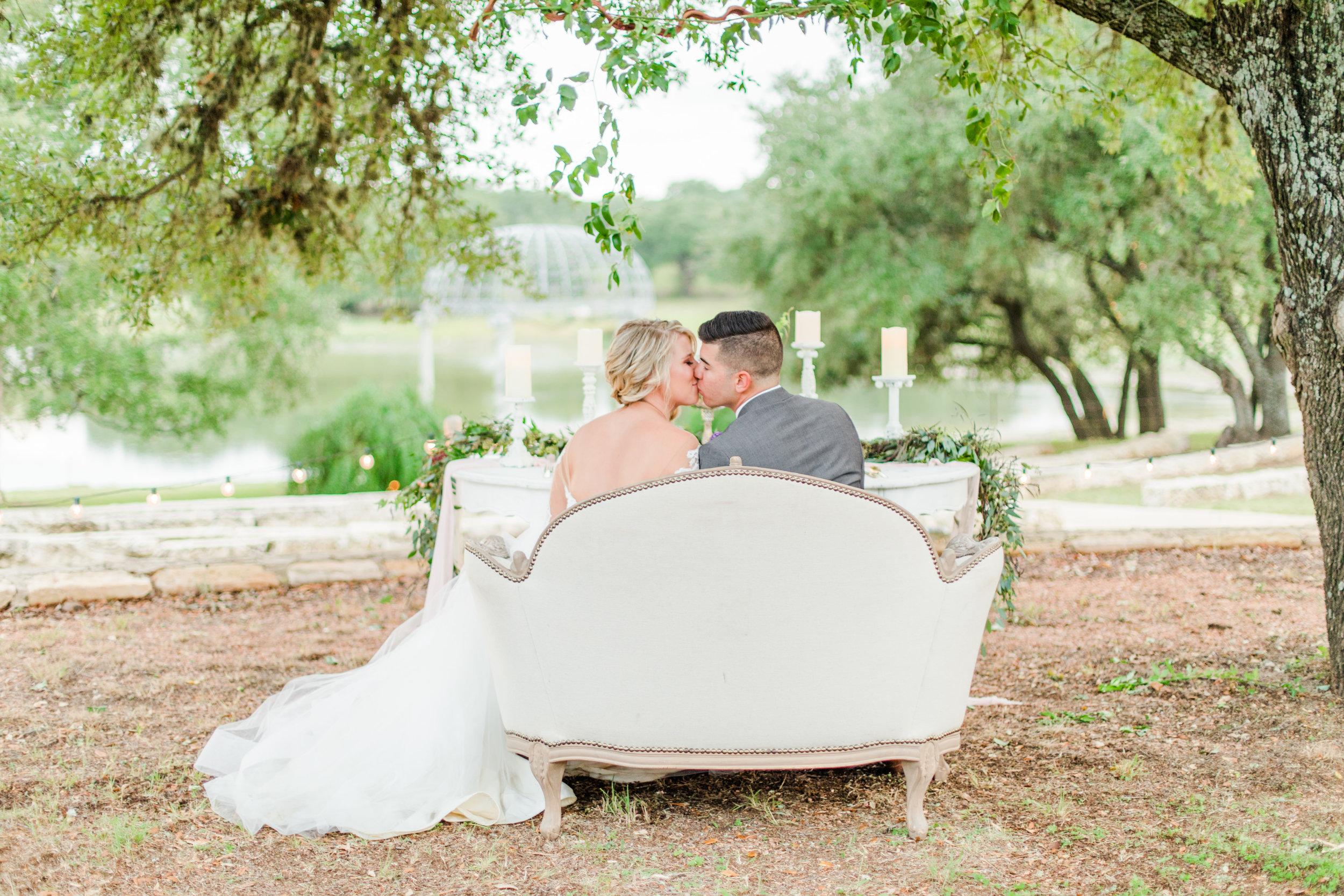 Couple kissing on terrace
