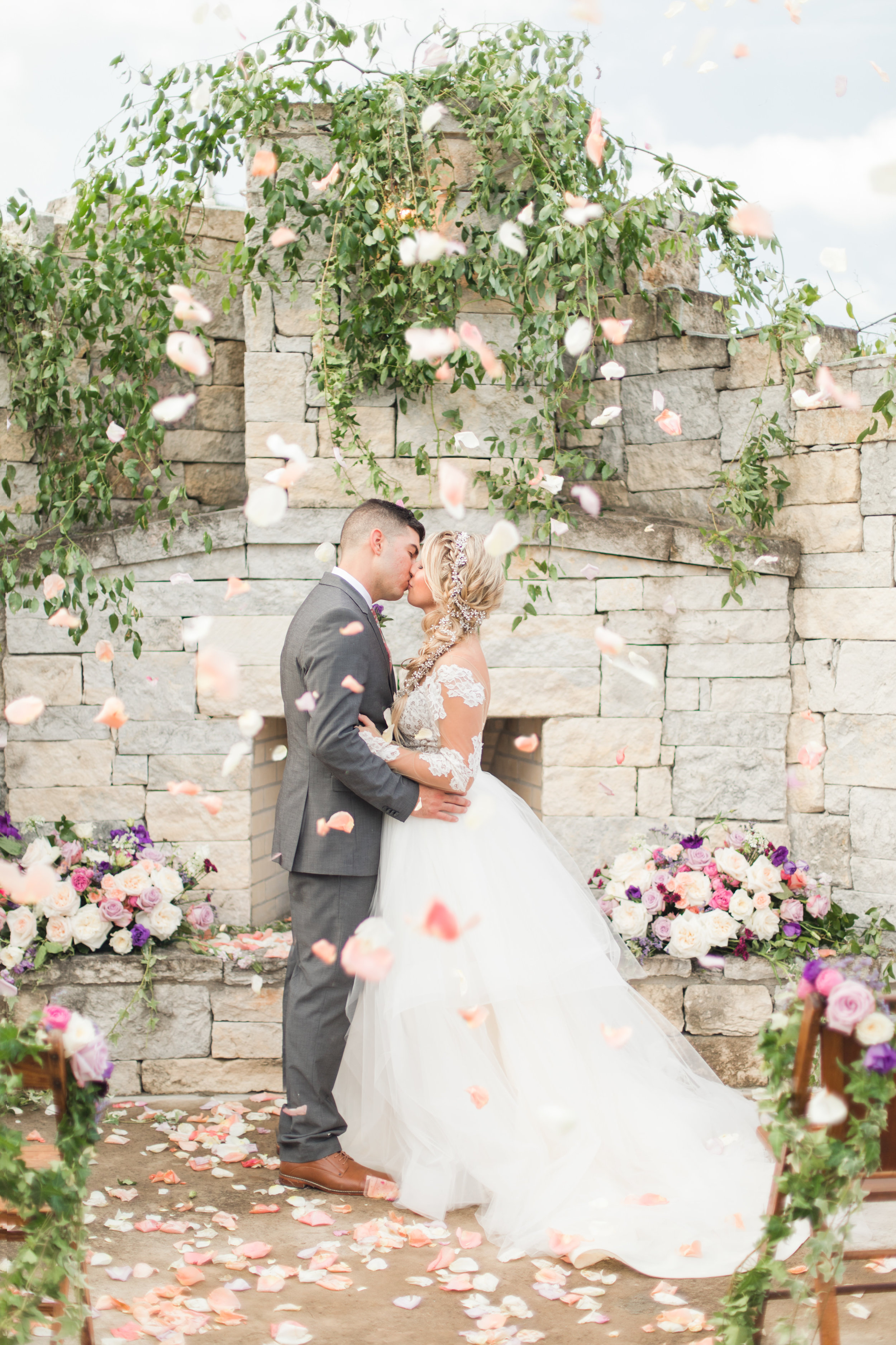 Carriage Hills Ranch - Texas Hill Country Venue -  couple at fireplace kissing - photography