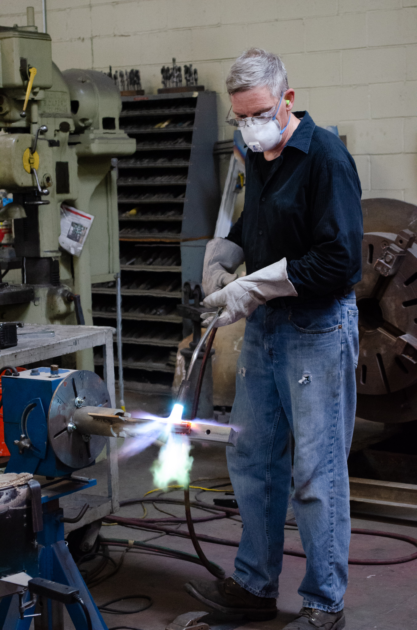 One of our expert craftsman applying heat on a spray and fuse repair