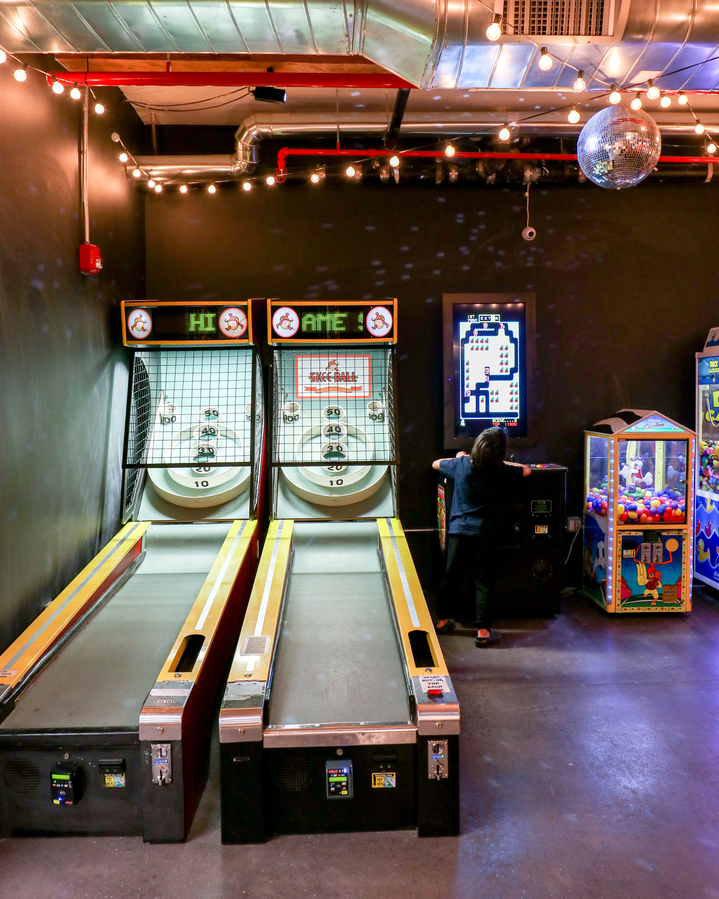 Games attract fun for all ages, skee ball, basketball, and a variety of others in Williamsburg