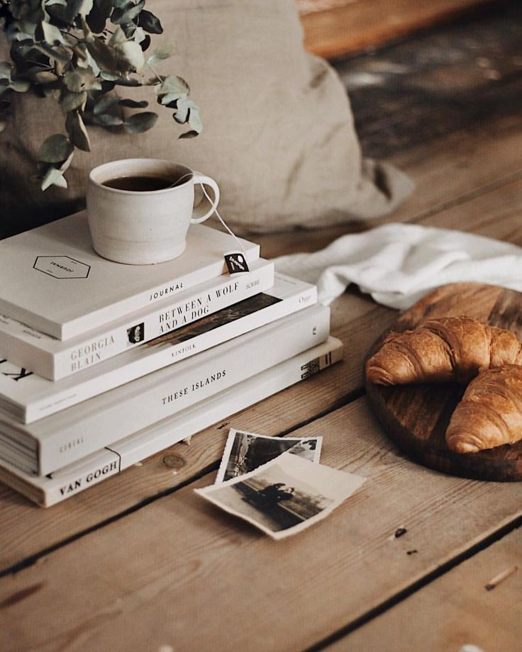 A quiet sunday moment with some of my favourite things— bare floorboards, vintage photographs & a stack of pretty white books ☕️✨ if you….jpeg