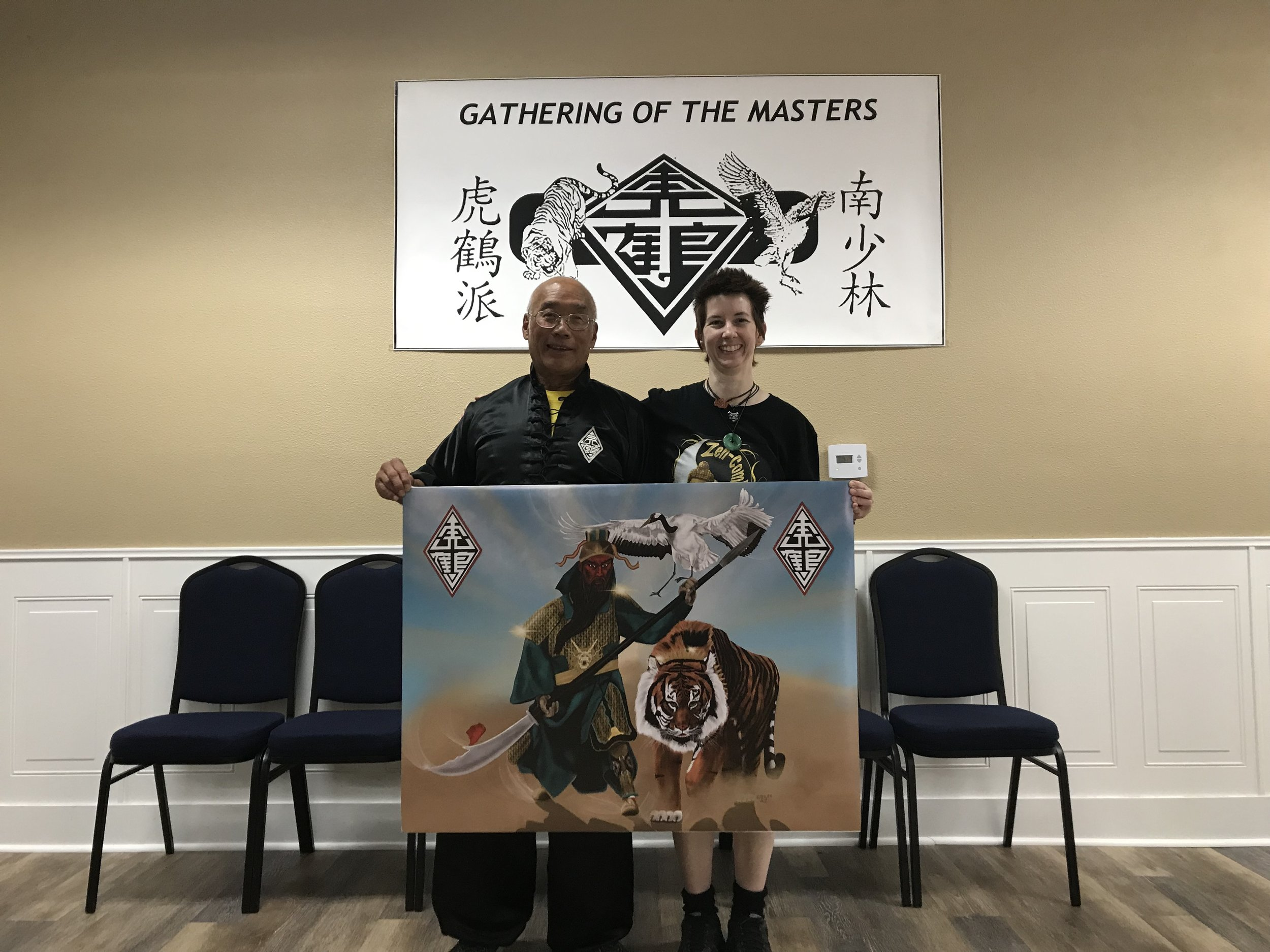 "Presenting a large copy of ""Guan Yu"" (Freehand Digital Drawing) to Grandmaster Fred Lee"