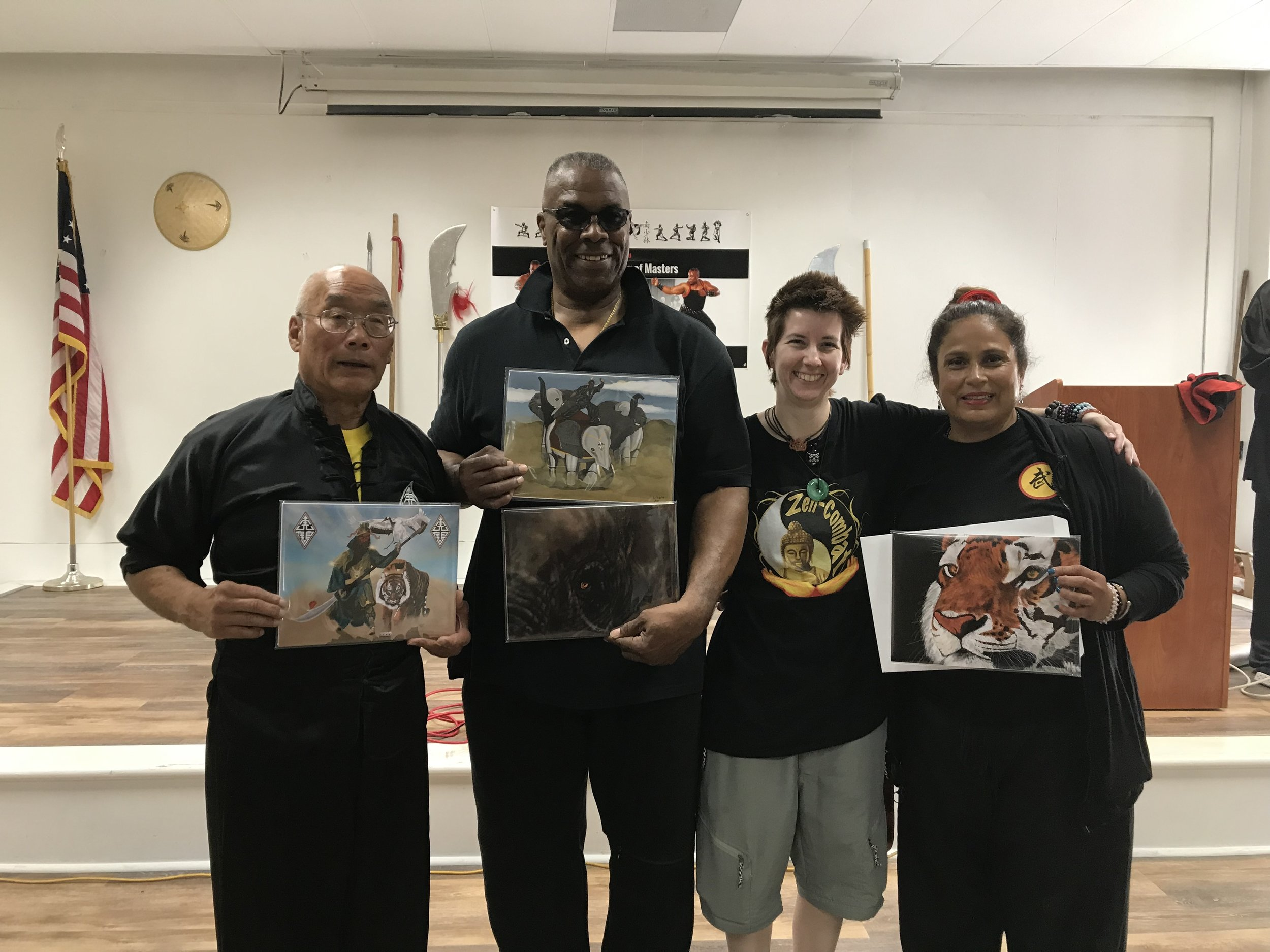 "Presenting Freehand Digital Drawings ""Guan Yu"" to Grandmaster Fred Lee, ""Looking Into The Soul Of A Mighty Elephant"" & ""The Mighty Elephant Warrior"" to Grandmaster Donald Hamby, & ""The Calm Before The Storm"" to Sifu Rosa Trenado at the 4th Annual Gathering Of The Masters, June 29, 2019."