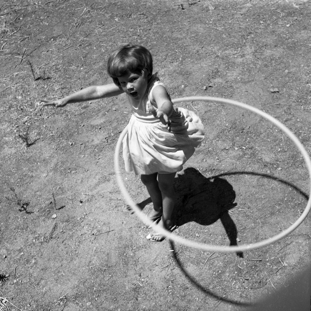 Girl_twirling_Hula_Hoop,_1958.jpg