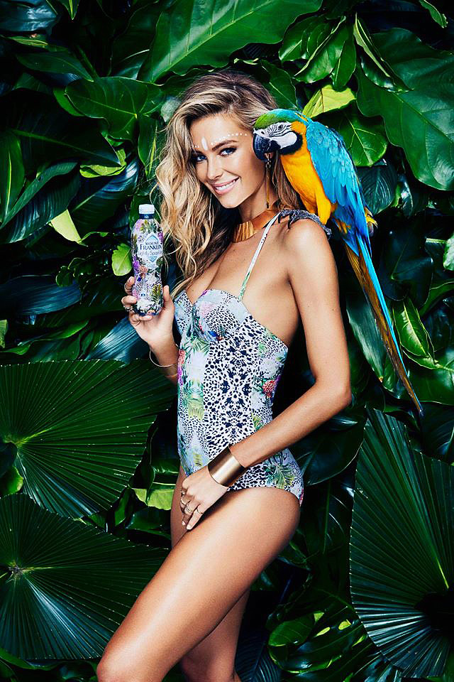 Kirsko Film Animals Jennifer Hawkins and Blue and Yellow Macaw.jpg