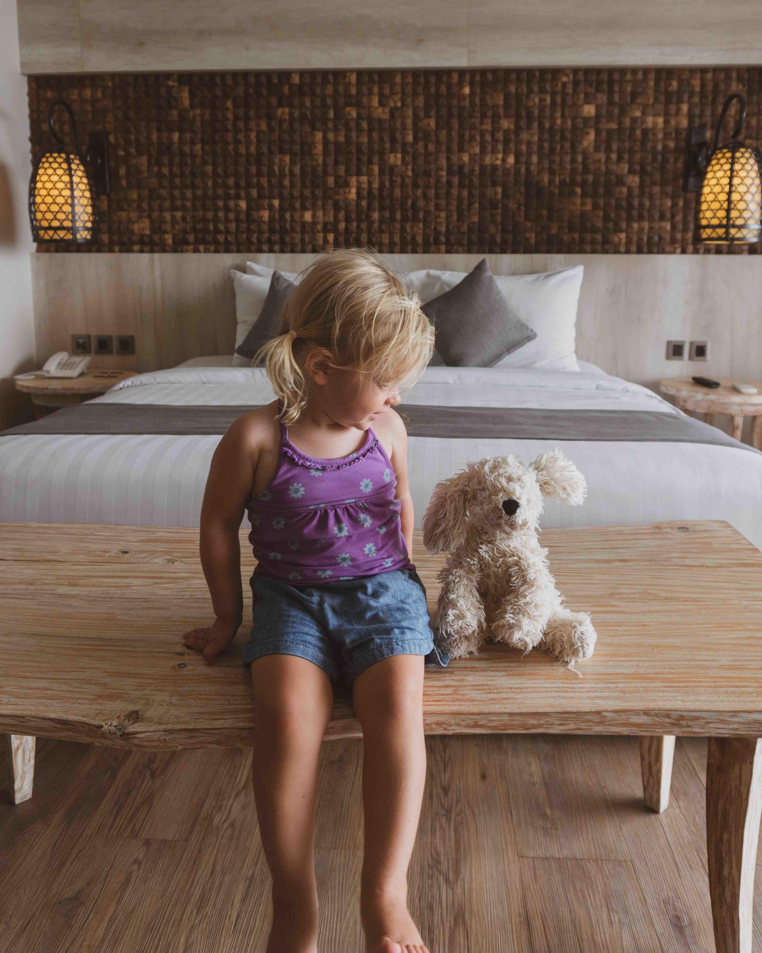 Jimbaran_Bali_family_hotel room_stylish space_bed_girl.jpg