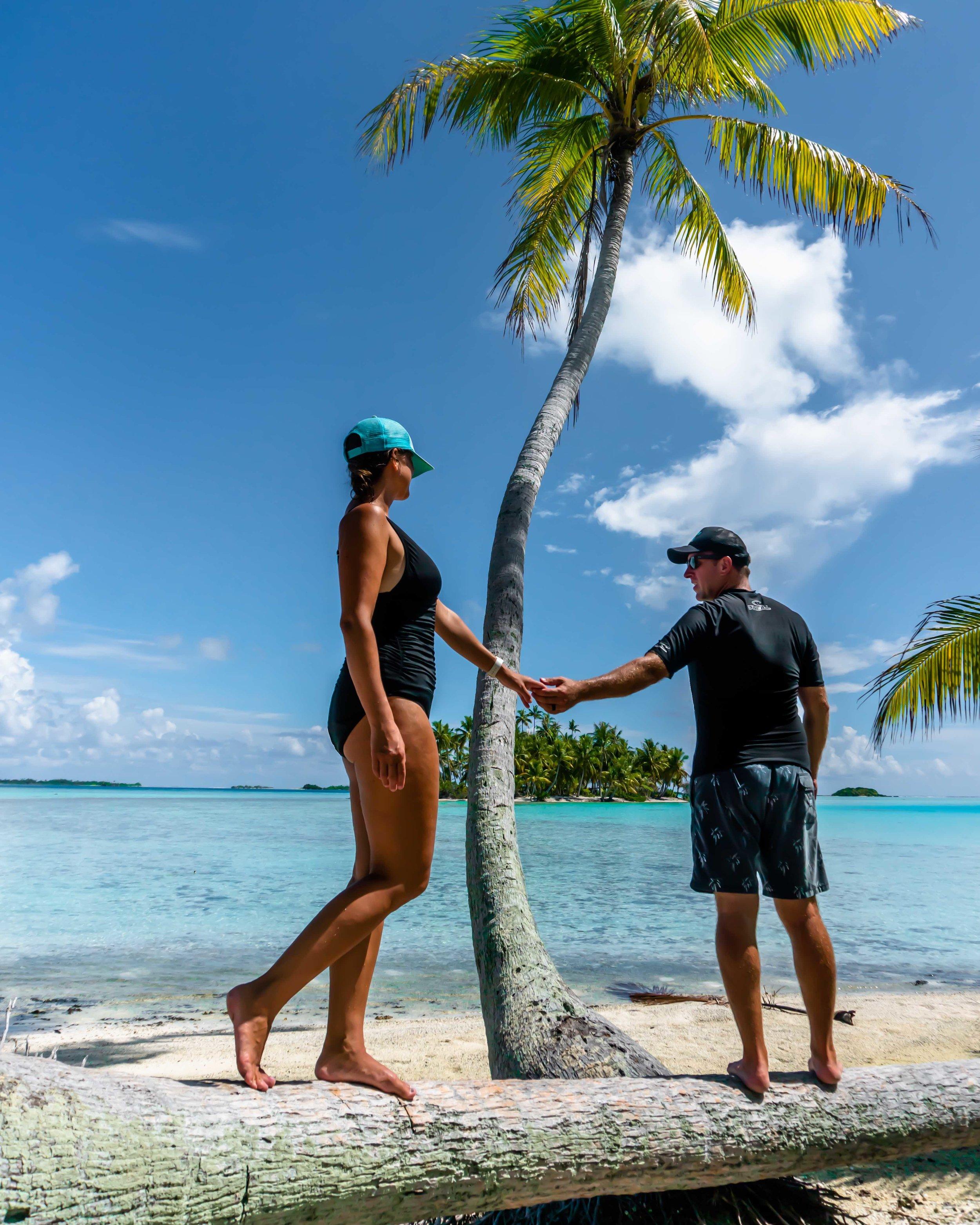 tropical_paradise_beach_island_rangiroa_couple_south pacific_beach_palm tree 3.jpg