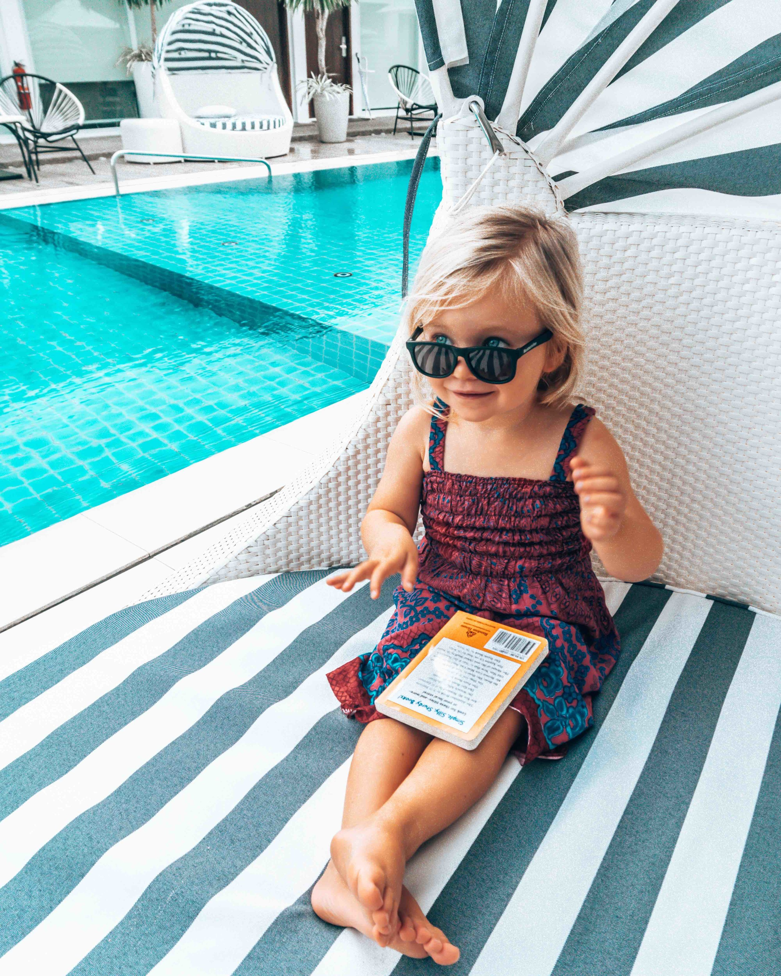 lifestyle_pool_hotel_coast_boracay_philippines_sunglasses_daybed_relaxing_book.jpg