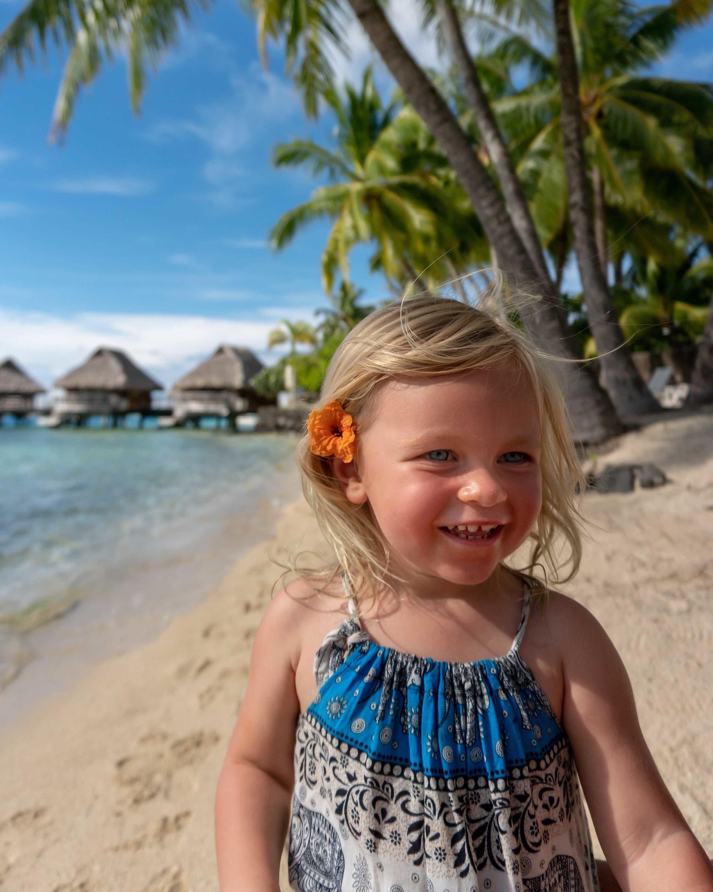 lifestyle_beach_bora bora_maintai_girl_overwater bungalows_flower.jpg