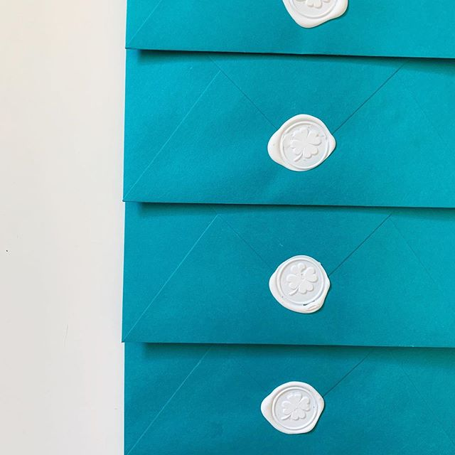 Feeling lucky 🍀 | This vibrant wedding suite is out for delivery! This particular client duo is doing something unique and extraordinary for their big day, and it only felt right that their wedding invitation suite followed suit. I'm saving the details for now, but love the contrast of these bright teal envelopes and clover wax stamp. More to come!