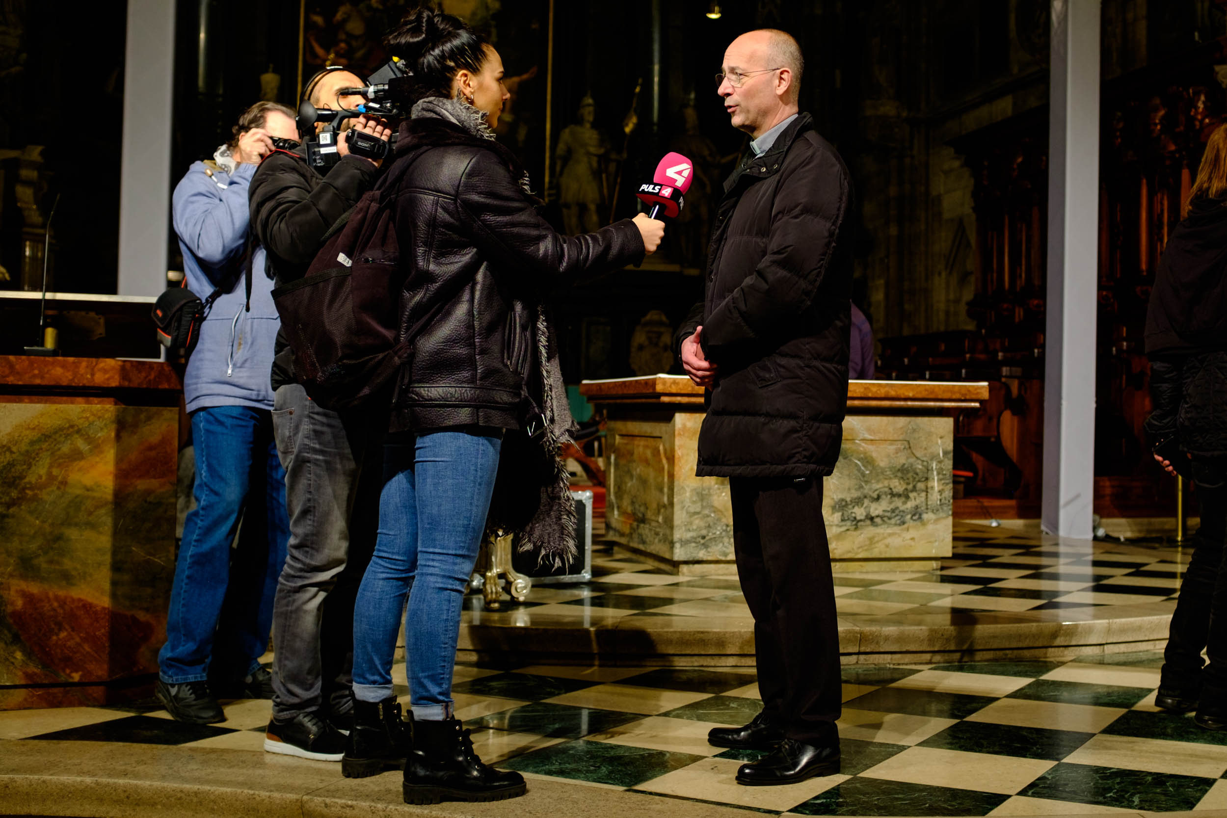 Toni Faber, priest of Stephansdom, being interviewed about the event, which he'd aimed to be a mixture of Falco and Mozart.